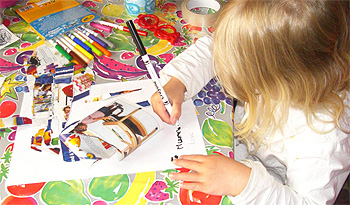 A child writing and collaging